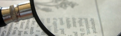 Image of magnifying glass. Evaluating TEL blog post cover image.