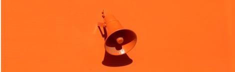 Decorative picture only - Bright orange wall and loud speaker.