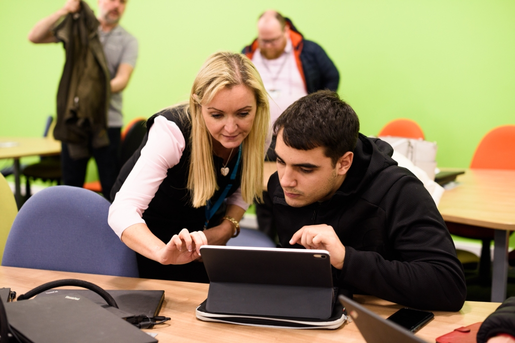 Louise Morgan and a student looking at the student app on the student's device.