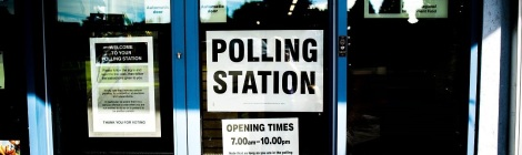 "Decoratve - Banner image - Photo of the doors of a polling station with a sign stating ""polling station"" in prominent view"