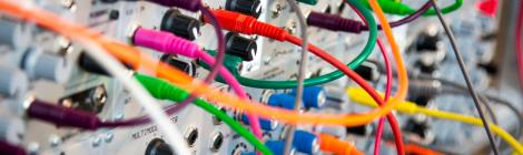 Decorative Banner - Multcoloured bables plugged into a complicated hardware array