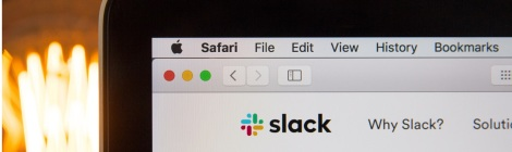 Decorative screenshot of Slack open within Safari web browser on a Mac computer